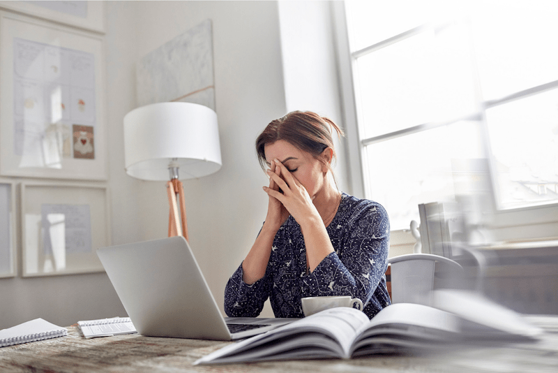 Small business owner overwhelmed by marketing